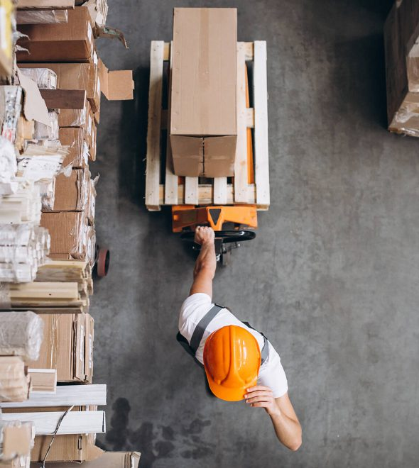 young-man-working-warehouse-with-boxes